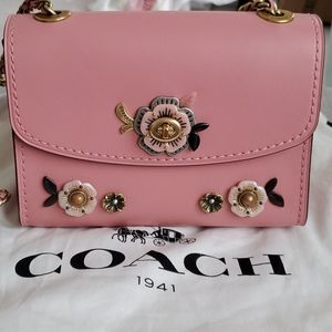 Coach tea rose embellishment Parker 18
